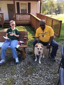couple with medium sized dog