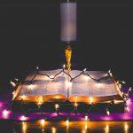 Lights on a Bible by zach lucero, unsplash