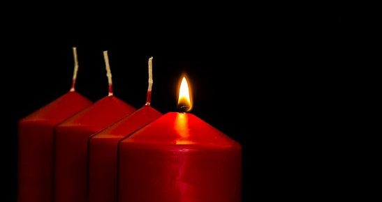 one candle lit out of four red candles by Myriams-Fotos, Piaxabay