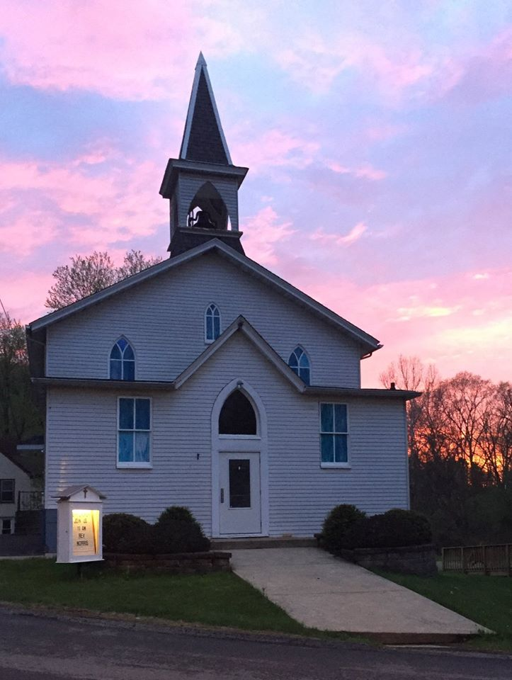 Kerr Presbyterian Church's white chapel with evening sunset