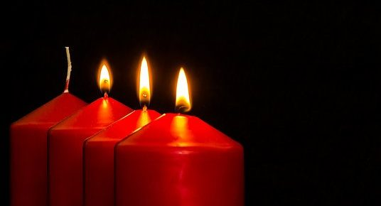three candles lit out of four by Myriam-Fotos, Pixabay