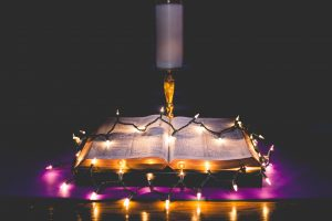 Lights on a Bible by zach lucero, unsplash