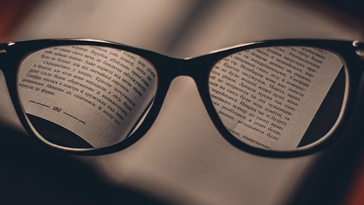 Glasses on a book from Pixabay