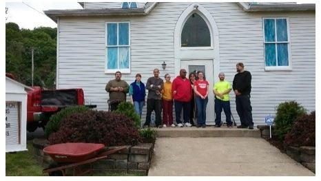 Volunteers standing in front of Kerr Church on a work day