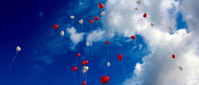 Heart balloons flying into the sky from Pixabay