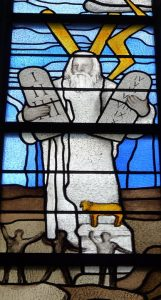Stained glass image of Moses with Lightning Bolts, image from Pixabay