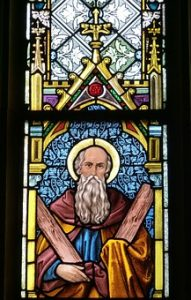 Stained glass window art of Moses with a Halo; image from Pixabay