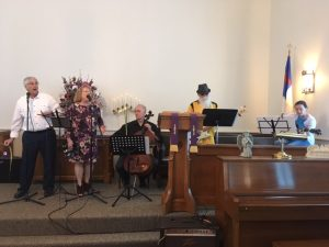 Palm Sunday musicans including cello, base, and guitar