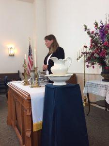 Rev. KJ Norris offering prayers at communion