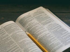 Bible with pencil, unsplash by aaron burden