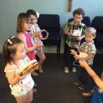 kids playing musical instruments at Kerr VBS 2018