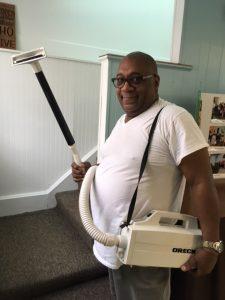 church member vacuuming