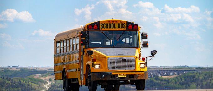 School Bus driving on the road by Denisse Leon, Unsplash