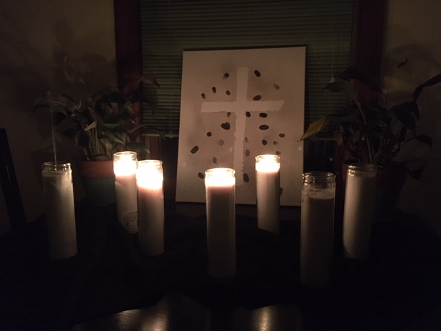 Good Friday arrangement of 7 candles, four lit