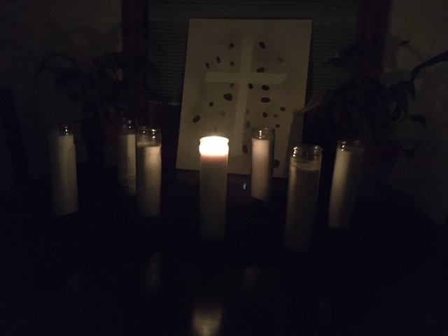 Good Friday arrangement of 7 candles, one lit