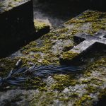 old grave covered in moss