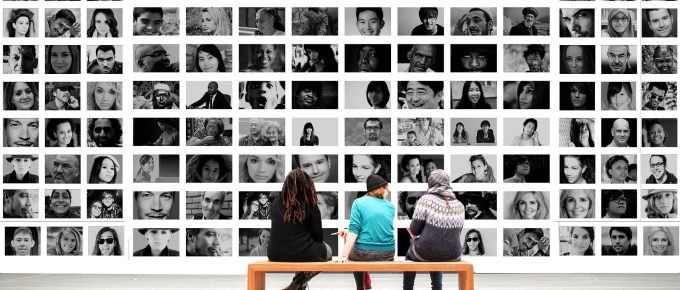 3 people sitting in front of a wall of human images, pixabay, Gerd Altman