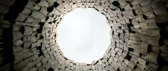 looking up through a stone well