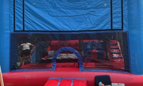 a bouncey house on the church lawn