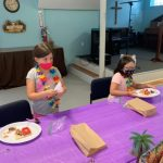VBS kids cleaning up