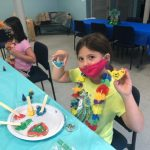 VBS kid holding decorated cookie2