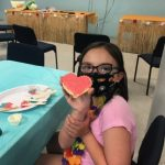 VBS kid holding decorated cookie